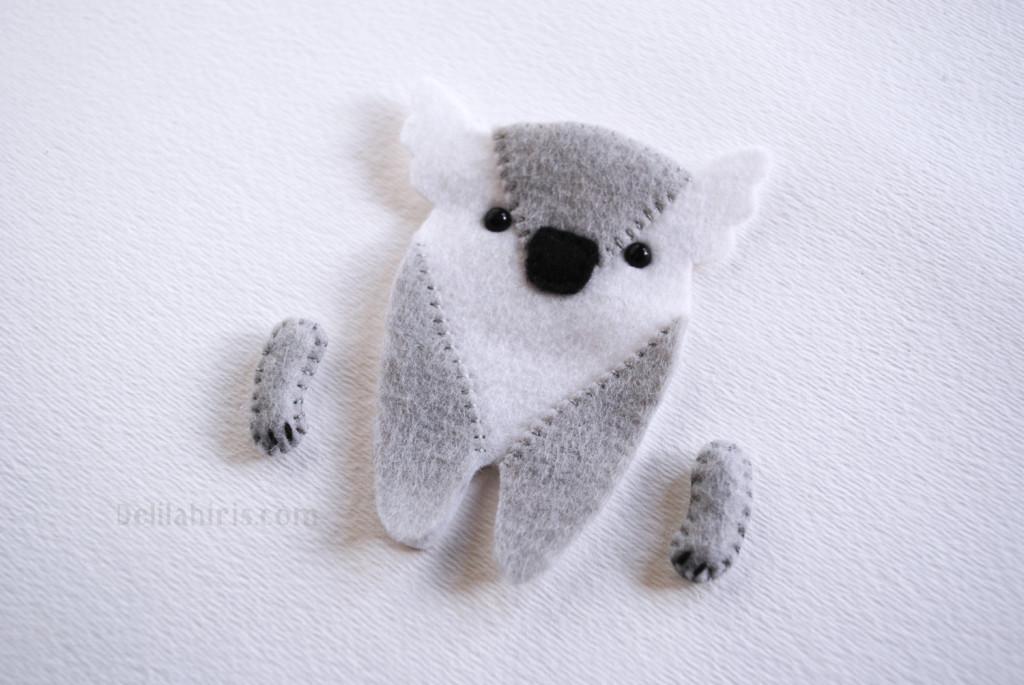sewing stuffed koala